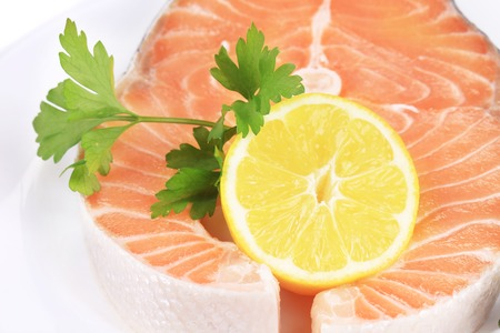 red fish: raw red fish and lemon  backgrounde on white