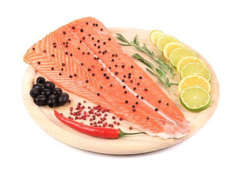 red fish: raw red  fish on wooden board on white  backgrounde Stock Photo