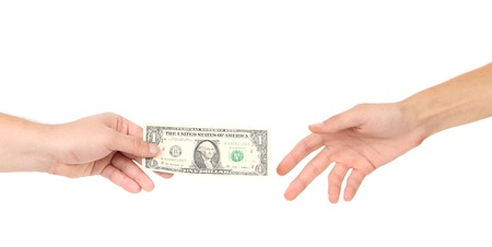Hand handing over money to another isolated on white Stock Photo