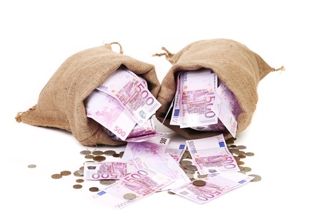 Two bags with much money. Isolated on a white background photo