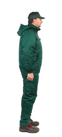 studio happy overall: Worker in green overalls. Isolated on a white background. Stock Photo