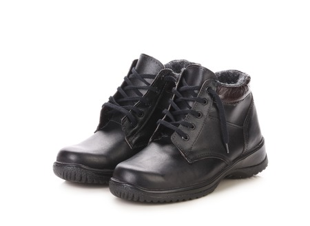 men s boot: Short black leather boots. Isolated on a white background.