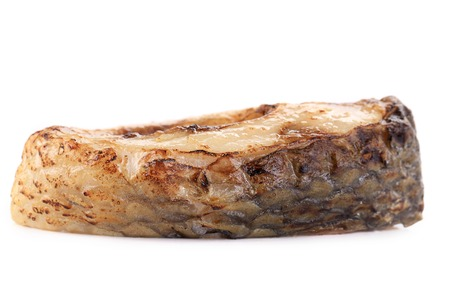 Grilled piece of fish. Isolated on a white backround. photo