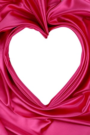 White heart of pink satin. Decorative background. photo