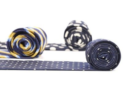 Three rolled multi-colored tie. Isolated on white background photo