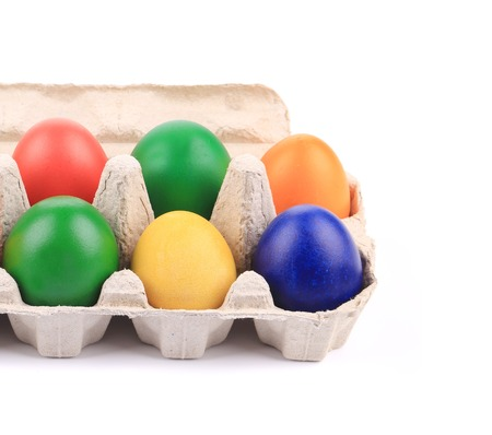 carboard box: Cardboard egg box with Easter colored eggs. close up