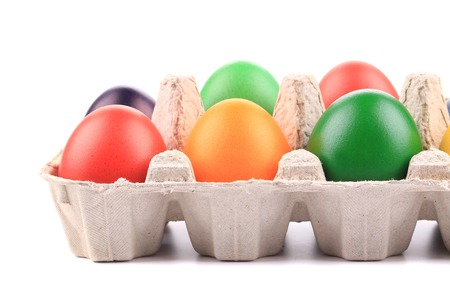 Cardboard egg box with Easter colored eggs. close up photo