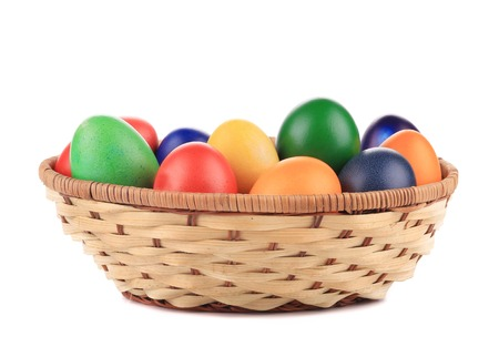 Easter eggs and basket isolated. Isolated on a white background. photo