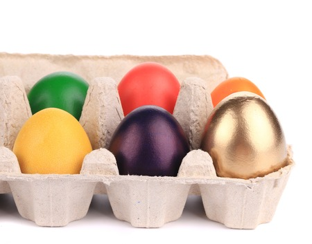 Colorful Easter Eggs in box. Whole background. photo