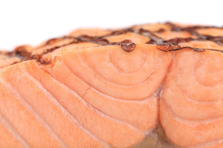 Close up of grilled salmon fillet. Whole background. photo