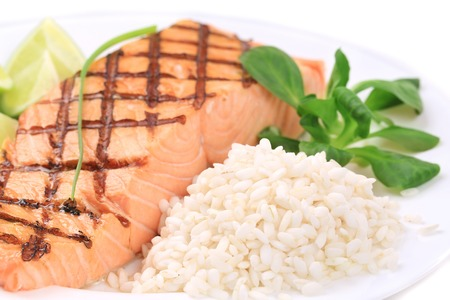 Roasted salmon fillets with rice. Whole background. photo