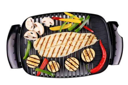Grilled seabass on grill with vegetables. Isolated on a white background. photo