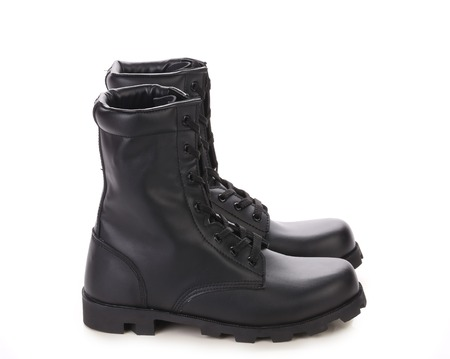 Men's leather high boots. Isolated on a white. photo