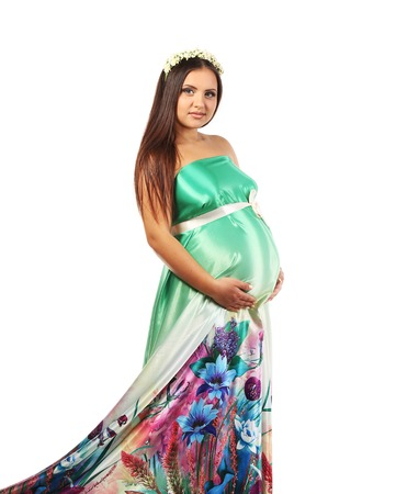 Beautiful young pregnant woman. Isolated on a white background. photo