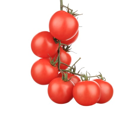 Composition of tomatoes cherry. Isolated on a white background. photo