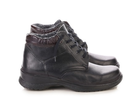 Close up of winter mans boots. Isolated on a white background. photo