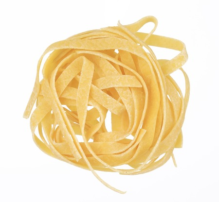 Tagliatelle paglia italian pasta. Isolated on a white background. photo
