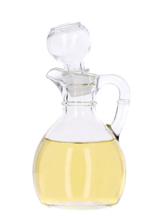 Vinegar in glass carafe. Isolated on a white. photo