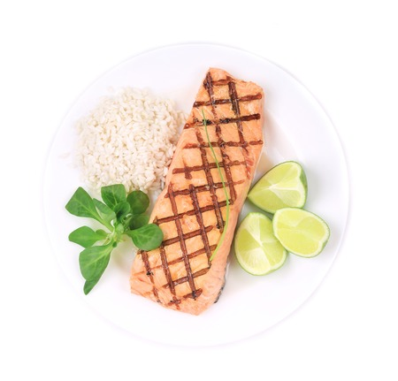 Grilled salmon filler with risotto. Isolated on a white. photo