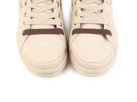 Beige sneakers. Isolated on a white background. photo