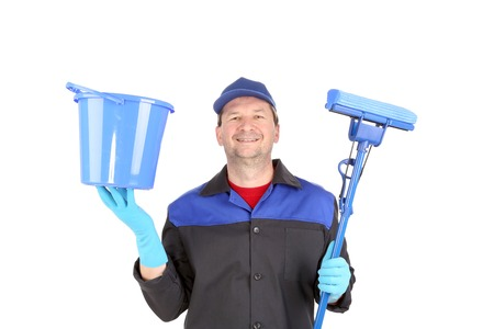 Man in workwear with bucket and mop. Isolated on a white background. photo