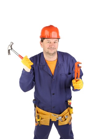 Worker in hard hat holding hammer. Isolated on a white background. photo