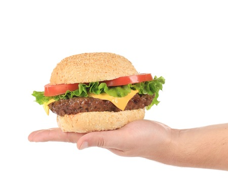 Big cheeseburger. Isolated on a white background. photo