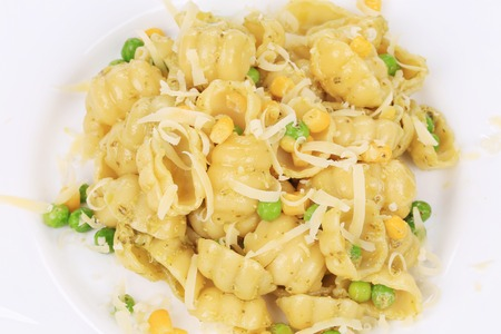 Pasta with cheese and pesto. Isolated on a white background. photo