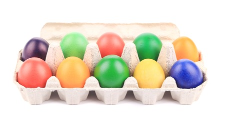 carboard box: Cardboard egg box with Easter colored eggs. isolated on a white background