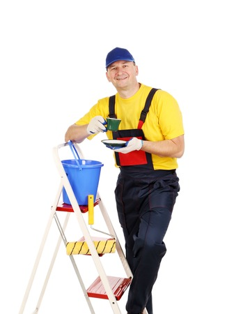 Worker on ladder with cup of tea. Isolated on a white background. photo