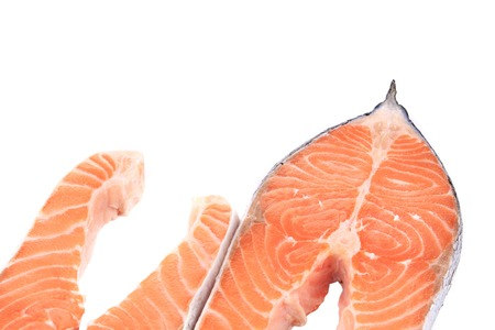 Two pieces of salmon. On a white background. photo