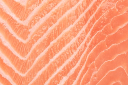 Close up of salmon fillet. Macro. Whole background. photo