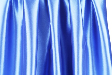 Creases in blue fabric. Isolated on a white background. photo