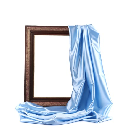 Wooden frame with blue silk. On a white background. photo