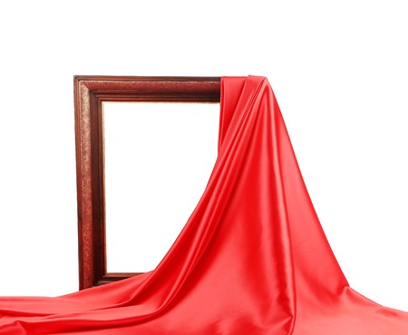 Wooden frame with red silk. On a white background. photo