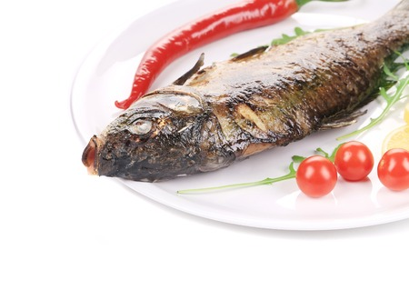 pikeperch: Grilled fish with vegetables. Isolated on a white background