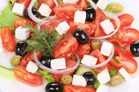 Close up of greek salad. Isolated on a white background. photo