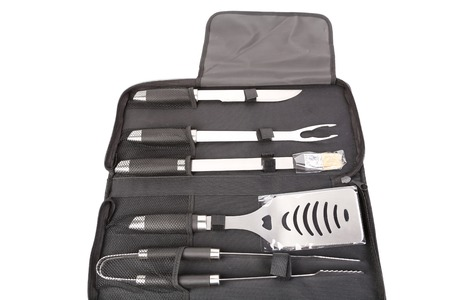 Set of tools for bbq in black bag. isolated on a white background photo