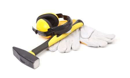 Ear protectors, hammer and gloves. Isolated on a white background. photo