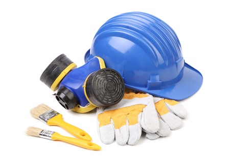 Safety helmet gloves and respirator. Isolated on a white background. photo