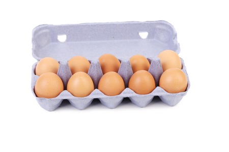 Ten eggs in a blue carton box. isolated on a white background photo
