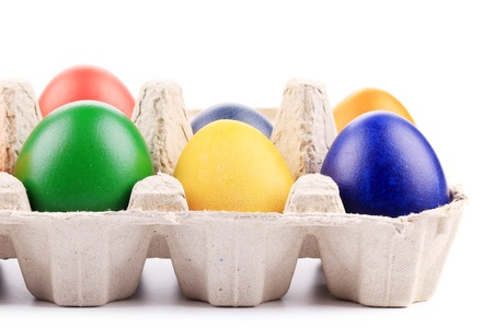 Colourful easter eggs in box. Isolated on a white background. photo