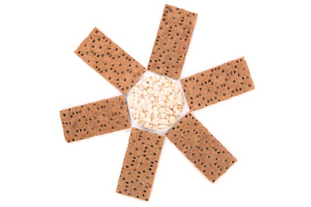 Biscuits and puffed round bread. Isolated on a white background. photo