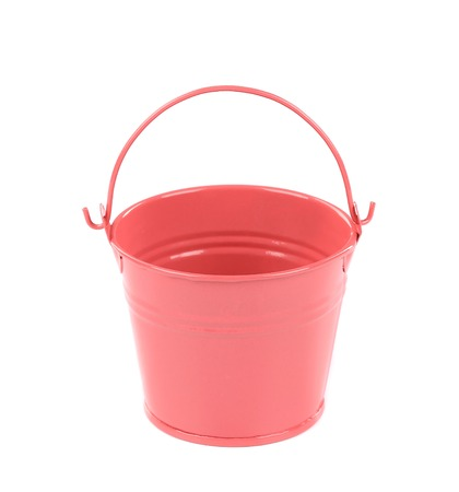Pink metal bucket with handle. Isolated on a white background. photo