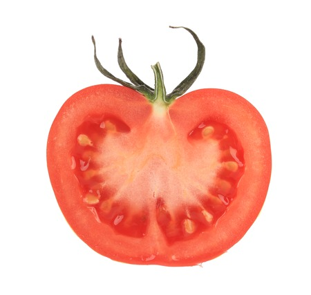 Cut half tomato. Isolated on a white background. photo