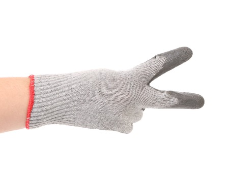 Hand in gloves shows two. Isolated on a white background. photo