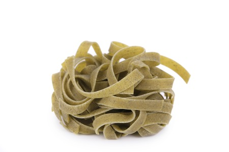 A portion of tagliatelle with spinach. Isolated on a white background. photo