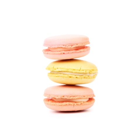 Stack of colorful macaroon cakes. Isolated on a white background. photo