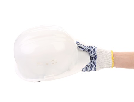Hand holding white hard hat. Isolated on a white background. photo