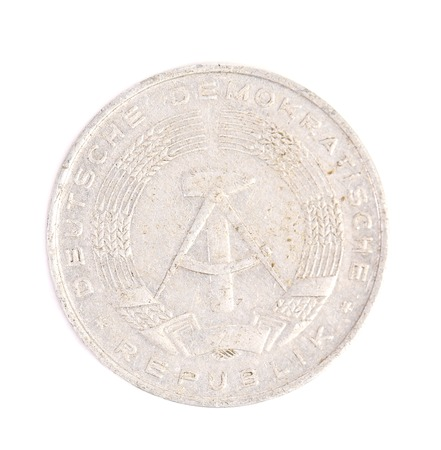 German pfennig coins. Isolated on a white background. photo